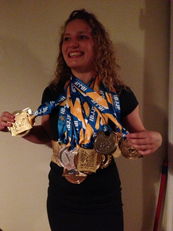 Showing off all of her medals from 2013 alone.